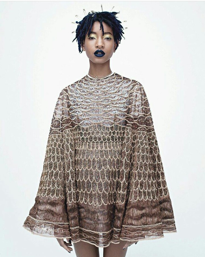 Willow Smith wears a Valentino Haute Couture cape dress; Dior Haute Couture ring (worn on chain, throughout); her own chain necklace and earrings